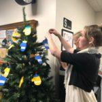 Decorating the Mitten Tree